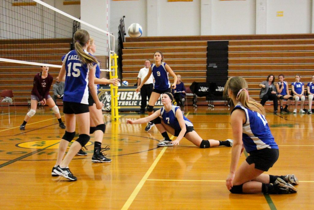 Fruitport's No. 7 Audrey Vereeke makes the dig to keep the rally alive. Photo/Jason Goorman