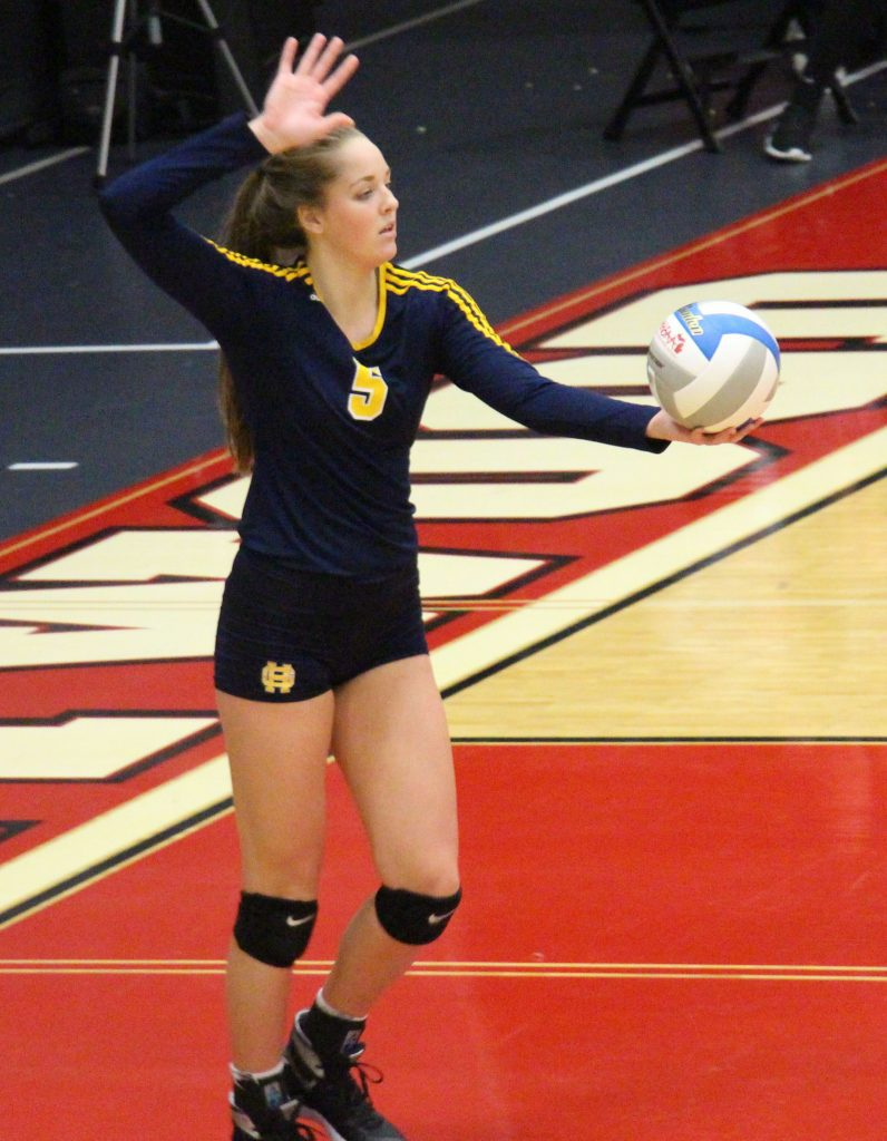 No. 5 Claire Holman prepares for the Grand Haven serve. Photo/Dave Hart