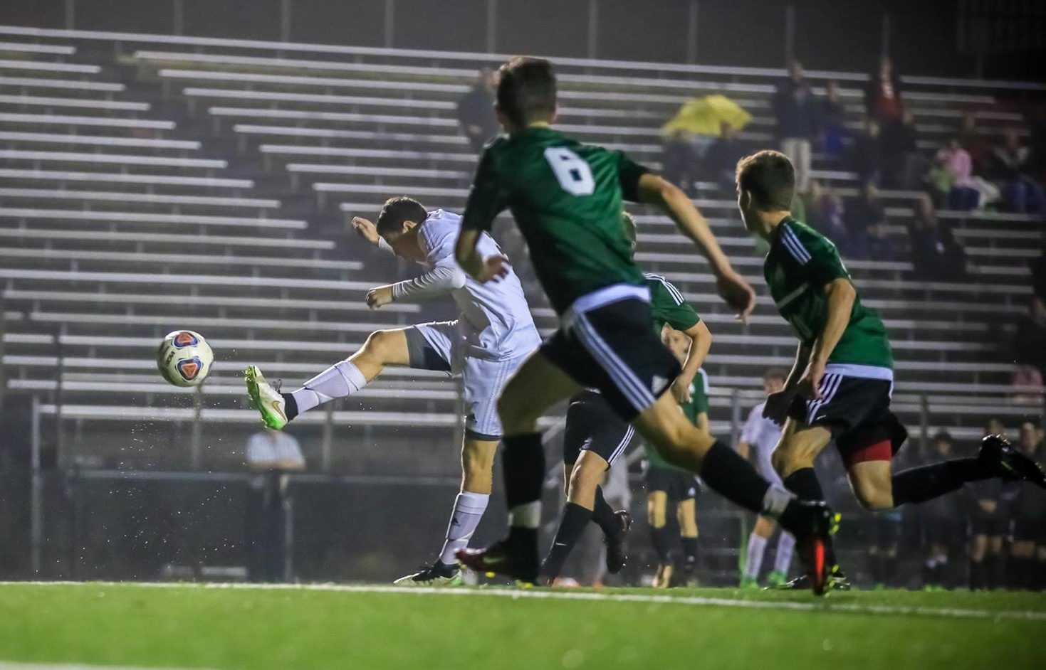Collin Powers blasts a shot that finds the back of the net for Muskegon Catholic. Photo/Tim Reilly