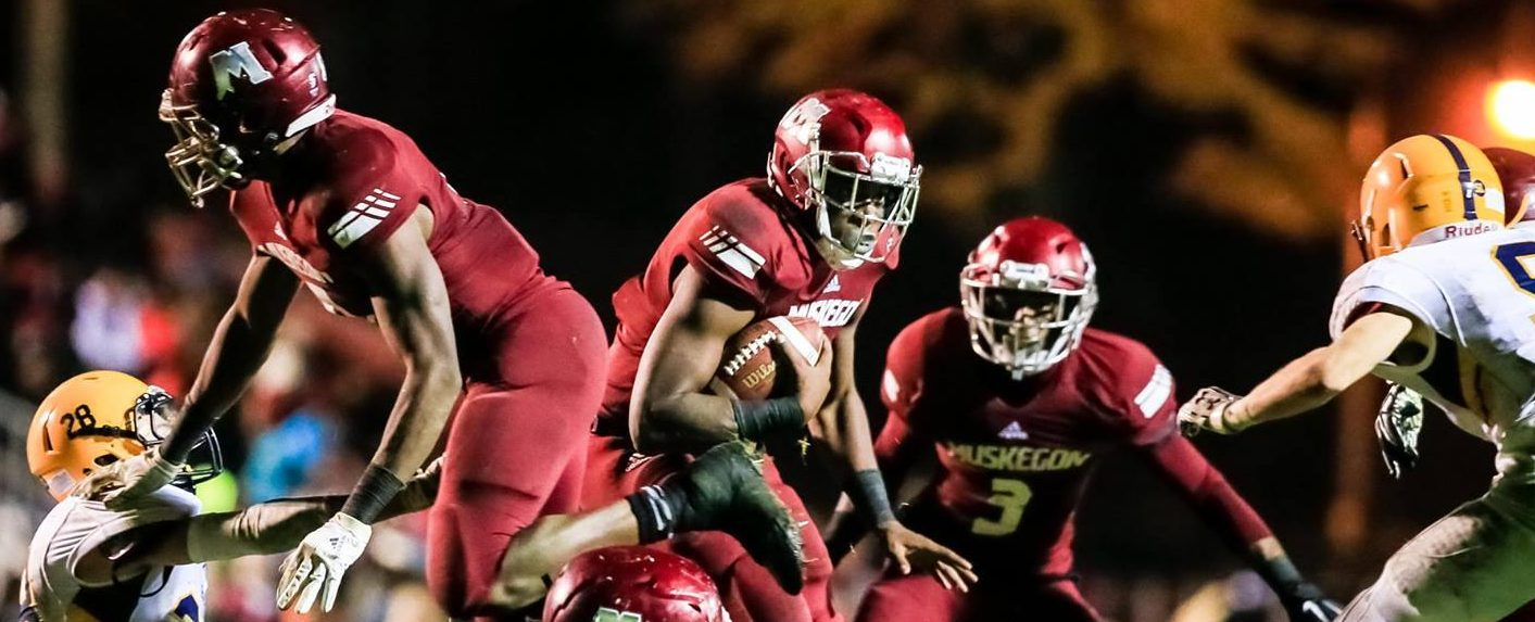 Big Reds respond to a challenge from East Grand Rapids, pull out a 28-10 win