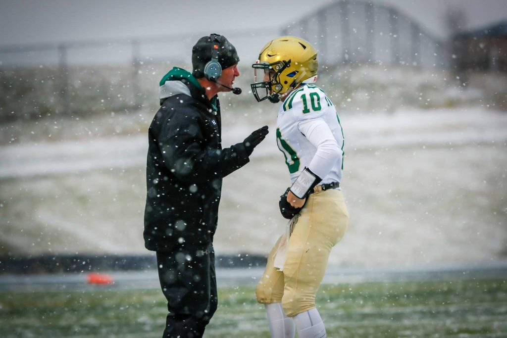 MCC Coach Steve Czerwon talks with QB Trenten Bordeaux in the quarterfinals. Photo/Tim Reilly
