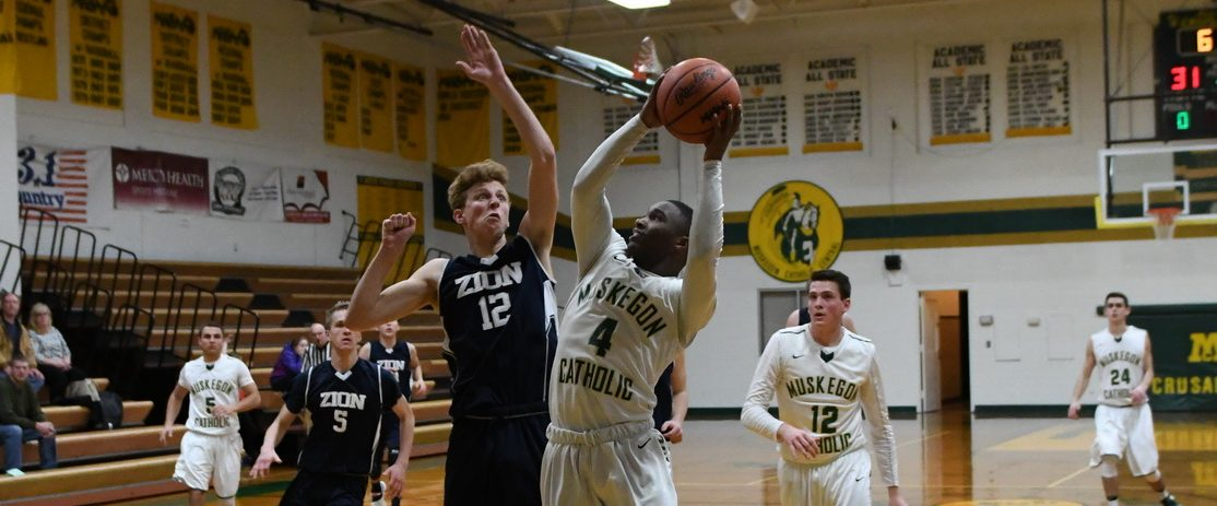 Photos from Muskegon Catholic Tuesday night boys and girls varsity basketball against Zion Christian