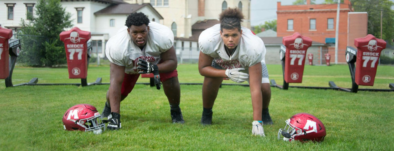 The Big Reds' big guys up front: College-bound Antwan Reed and Anthony Bradford