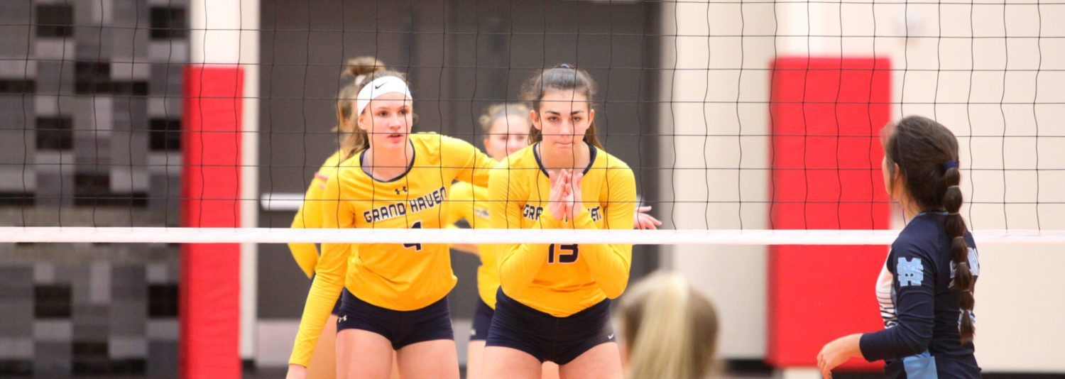 Grand Haven downs Mona Shores in three sets, wins 11th straight district title