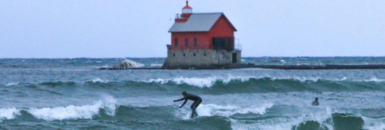 Lake Michigan kicks up Saturday afternoon waves at Grand Haven Beach