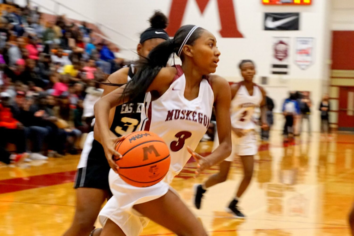 Big Red girls play East Kentwood tough for one half, then fall 69-44 in season opener