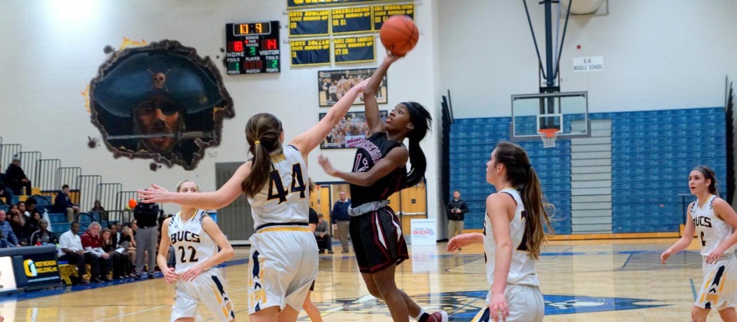 Muskegon girls basketball squad wins a close contest over Grand Haven, 39-37