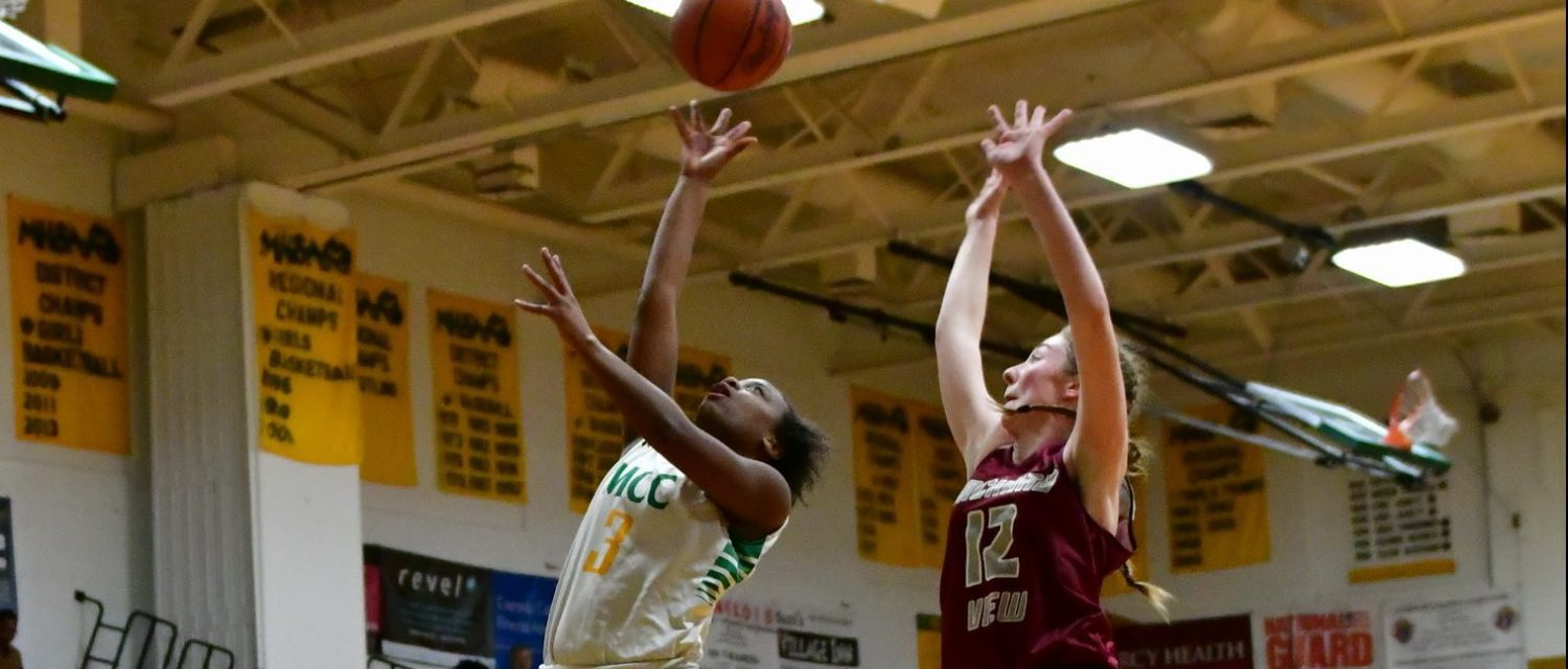 Photo gallery from Muskegon Catholic boys and girls varsity basketball wins over Orchard View