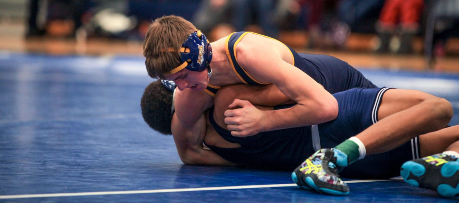 Determined Grand Haven wrestling team battles its way to a Division 1 district title