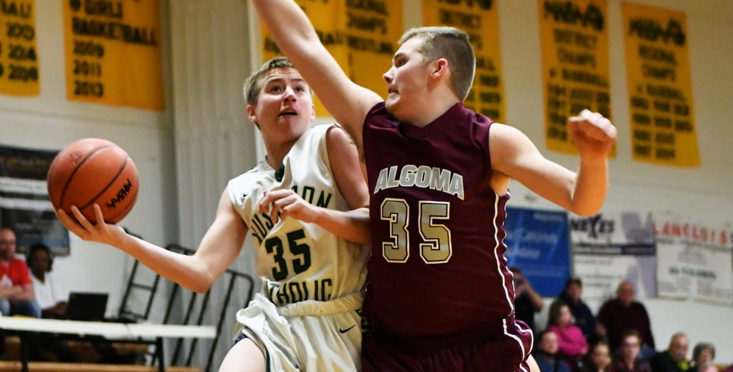 Muskegon Catholic boys basketball squad opens strong, defeats Algoma in districts