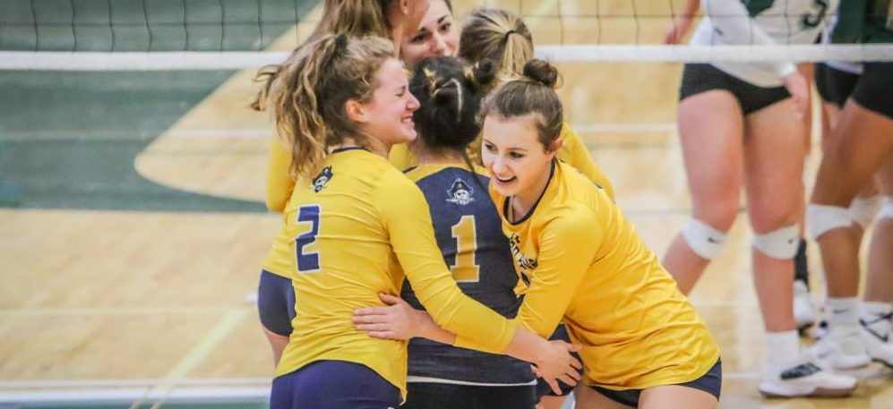 Grand Haven wins its 12th consecutive district volleyball championship