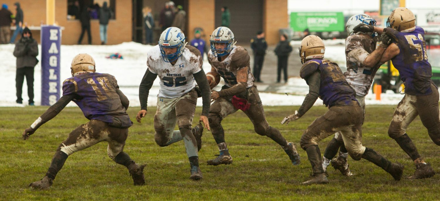 Stark runs wild in the mud as Montague beats Schoolcraft, advances to state semifinals