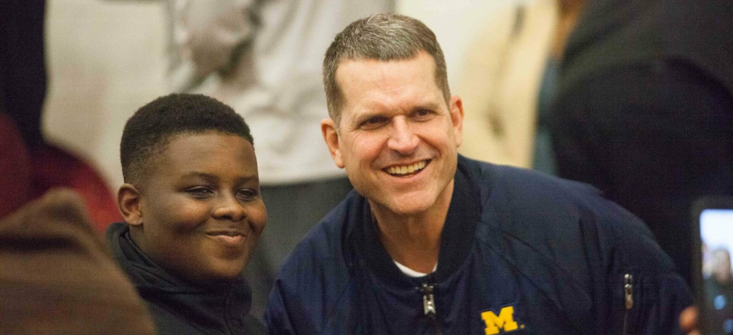 Harbaugh causes an excited stir during his visit to Big Reds basketball game