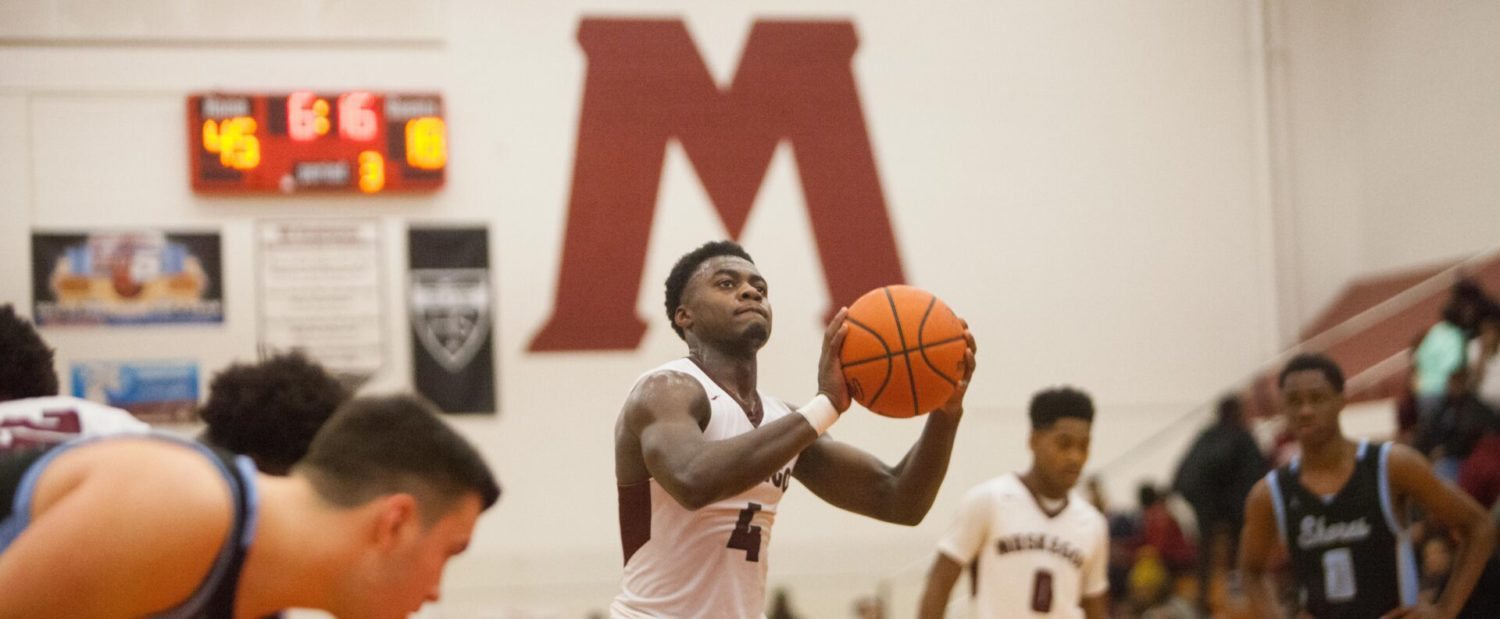Walker opens his Big Red career in style, scoring 21 in an easy victory over Mona Shores