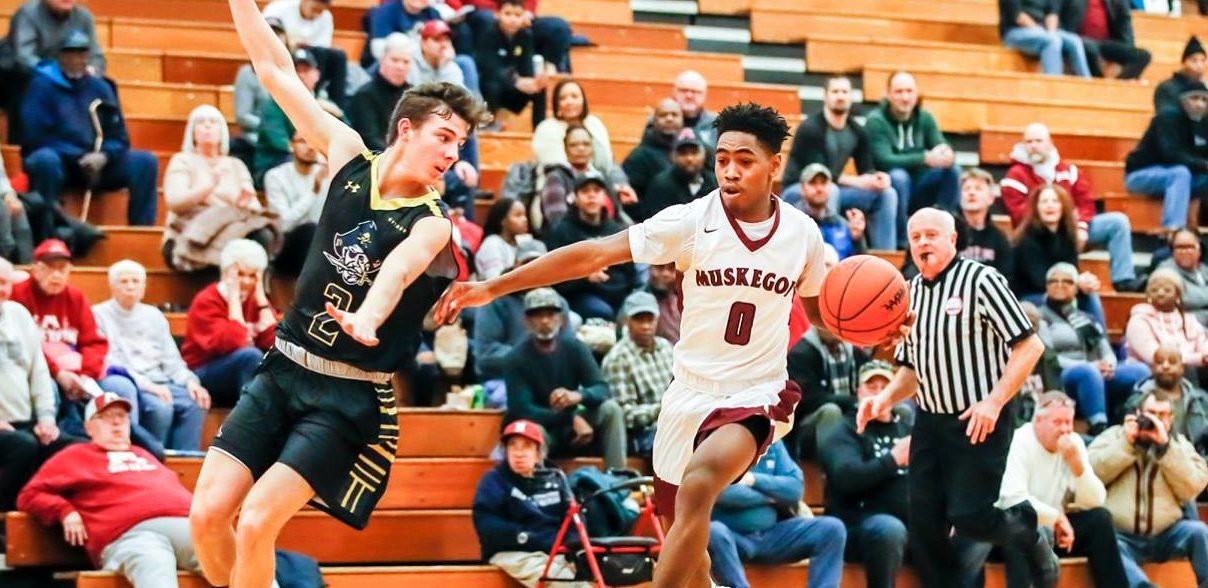 Big Reds hold up against determined Grand Haven, win 64-57 in district tournament opener