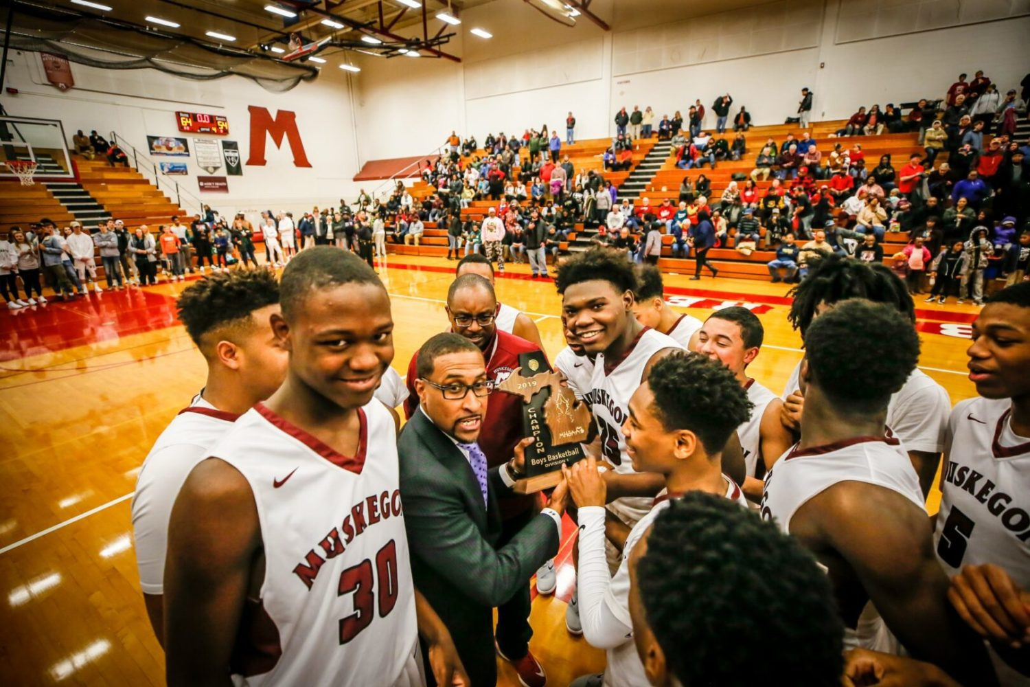 Big Red Coach Keith Guy's district title streak reaches an amazing 16 straight seasons