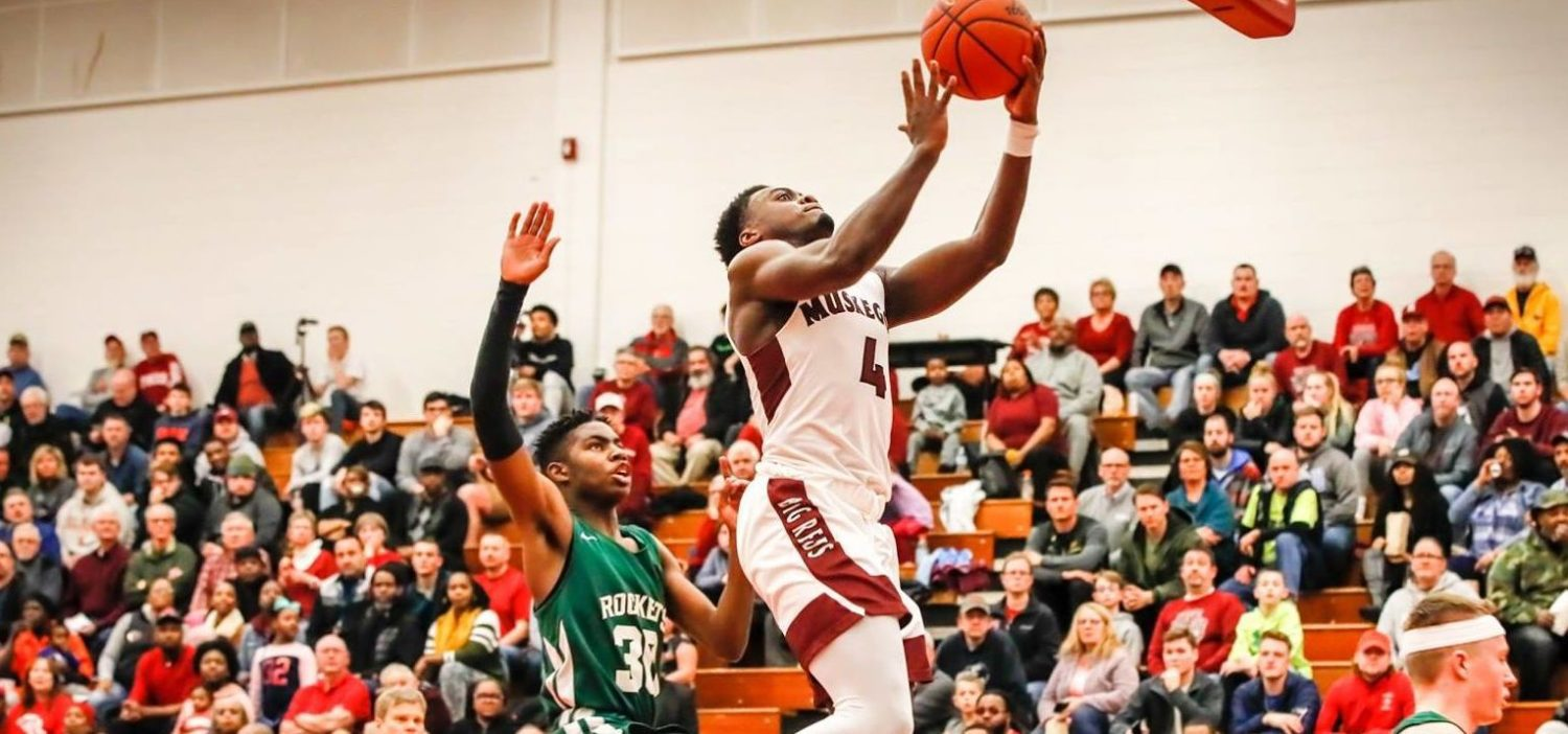 Jarvis Walker pumps in 32 points as the Big Reds down Reeths-Puffer 69-59 in D1