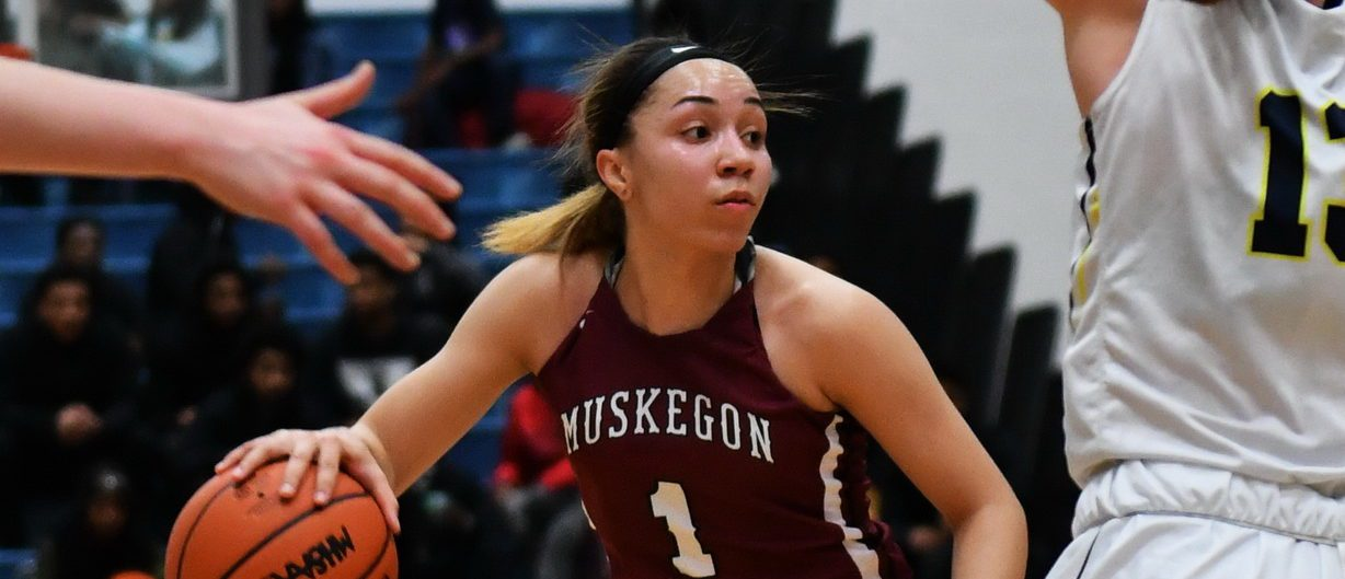 Big Red girls turn up the heat on defense, beat Hudsonville, claim second straight regional title