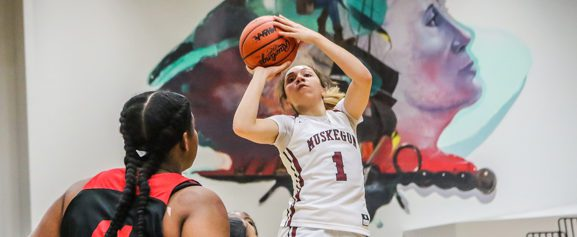 Winston explodes for 34 points, Big Red girls pound East Kentwood 67-46 in regional opener