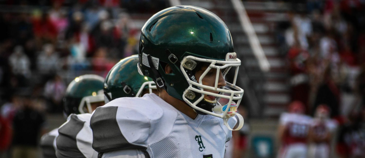 Logan Pearson rolls for 345 yards, 3 TDs in Hesperia's 52-14 win over archrival Holton