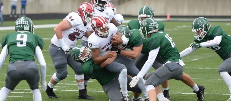 Martinez and receivers show off Big Reds' passing attack in a 49-10 win over Jenison
