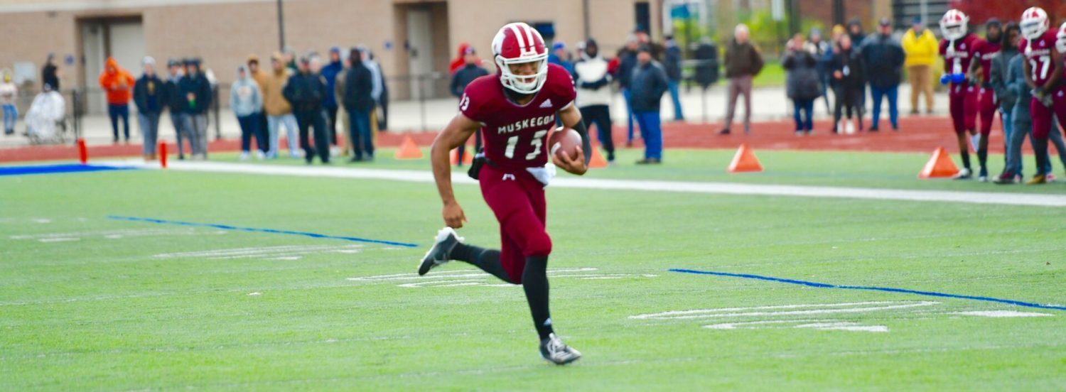 Martinez explodes for 7 TDs in first half, Big Reds blast Marquette 69-7 in Division 3 playoff opener