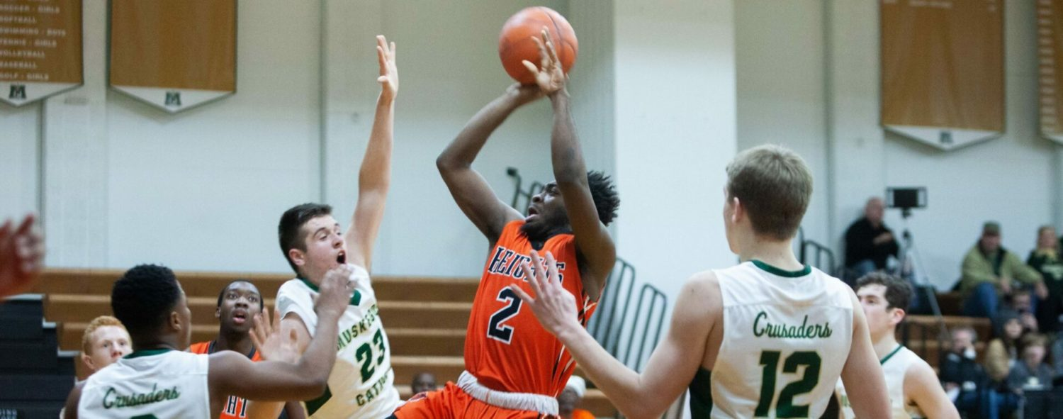 Muskegon Heights boys roar back for a 51-48 conference win at Muskegon Catholic