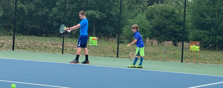 Joe Buck gives Norton Shores tennis whiz kids Drew and Reid Hackney national exposure