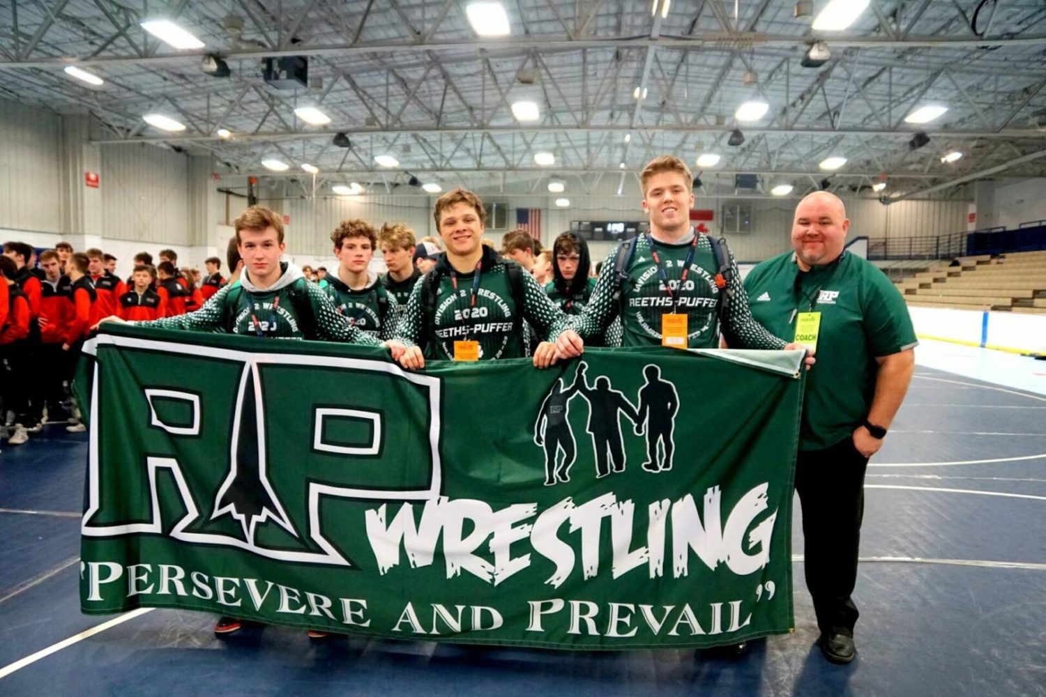 Reeths-Puffer's dream wrestling season ends with a loss to powerful Lowell in semis