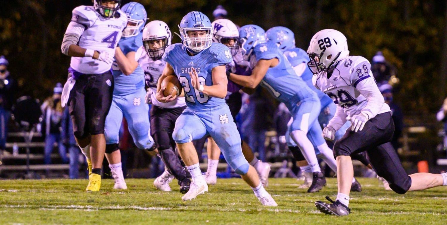 Defending champion Sailors begin playoff march with 54-6 win over Wyoming