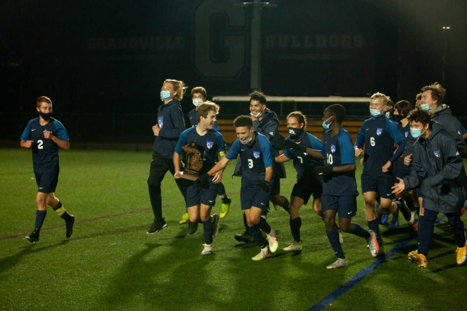 Yaros scores, DeKuiper gets the shutout, and Mona Shores soccer team wins first district title in memory