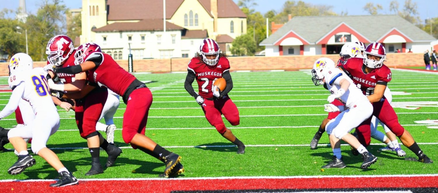 Muskegon Big Reds use big plays to roll past Greenville 56-7 in first round Division 3 playoff game