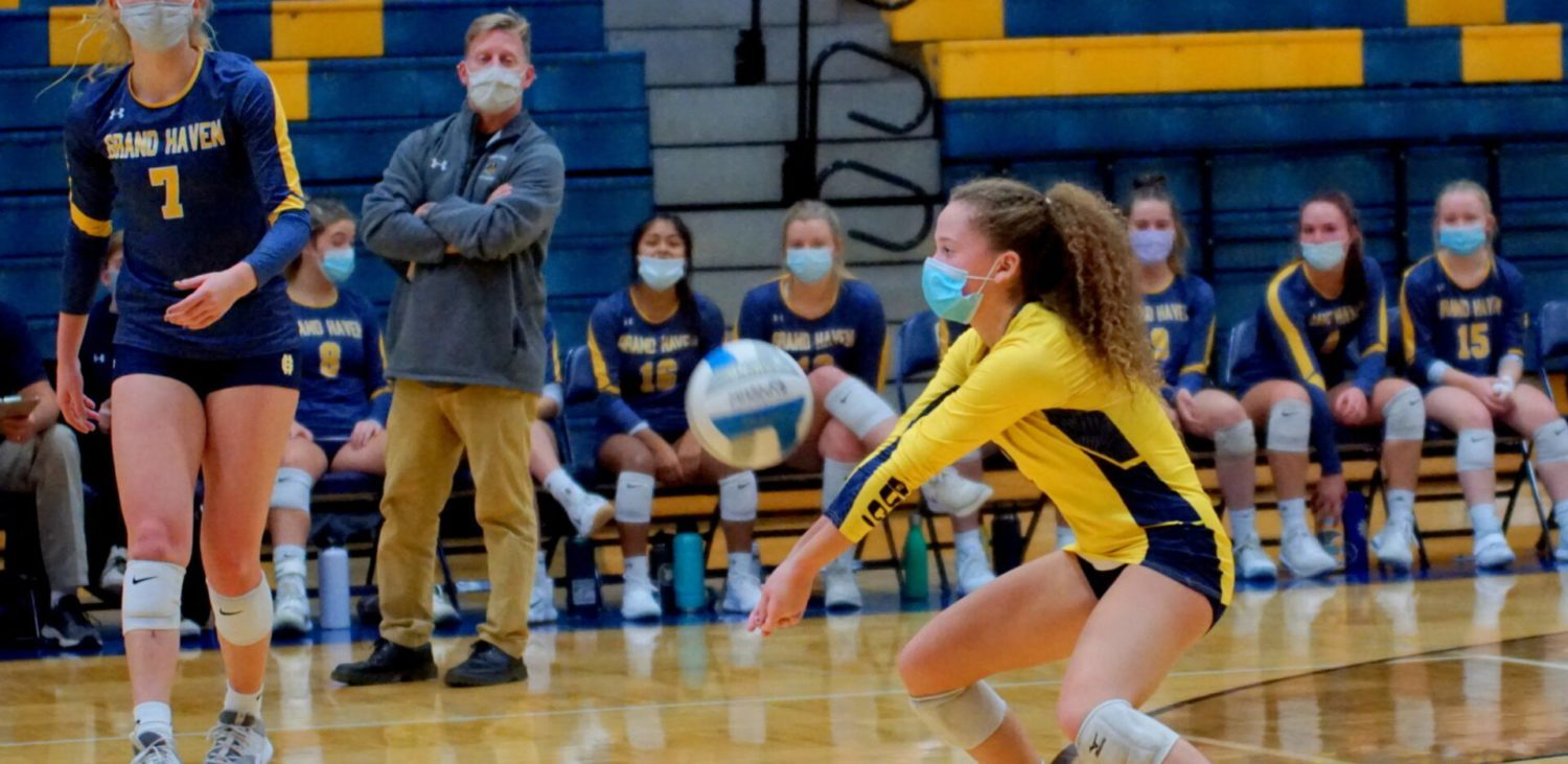 Grand Haven volleyball team overcomes challenges, beats Mona Shores in district tournament opener