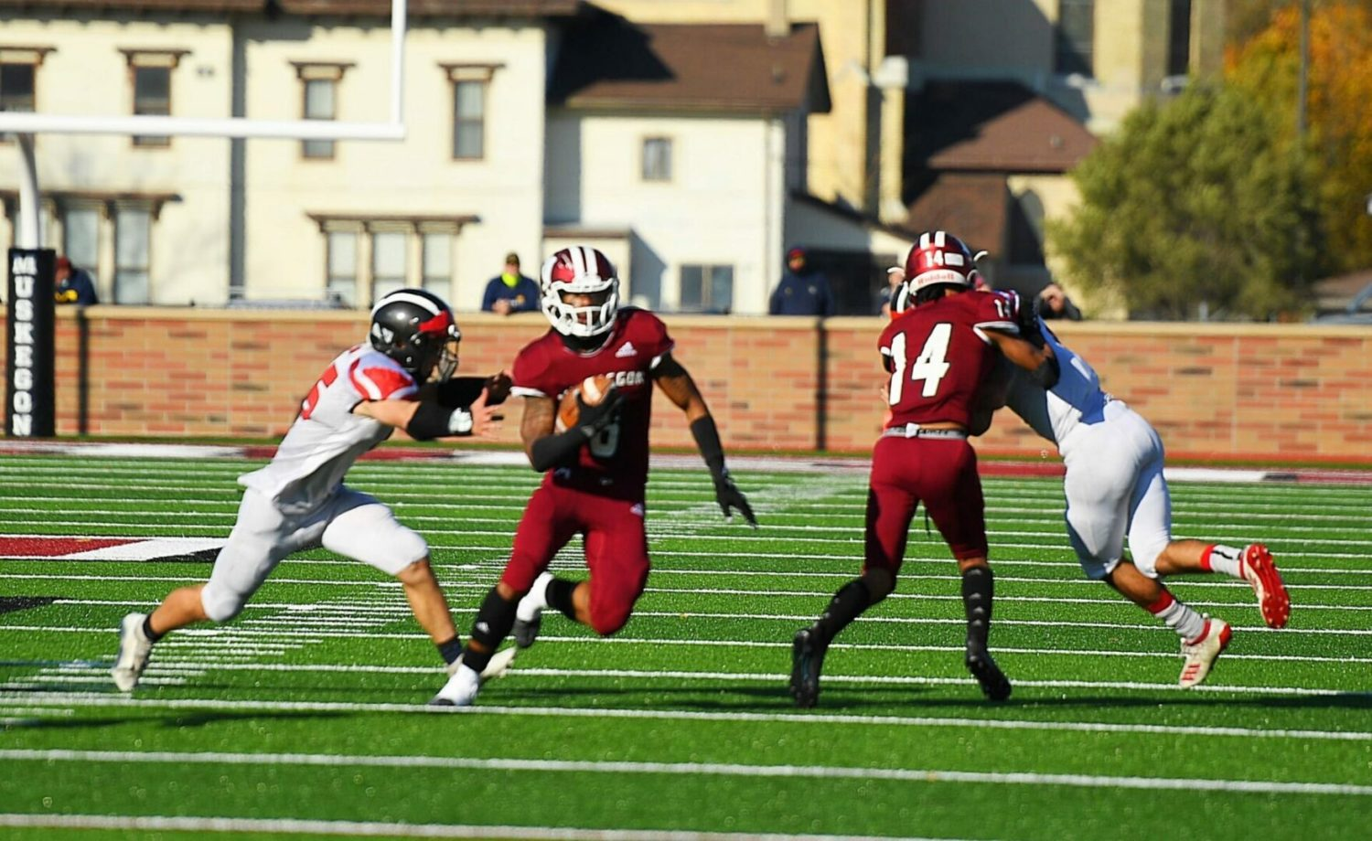 Muskegon Big Reds roll on offense in their 34-12 district semifinal playoff victory over Cedar Springs