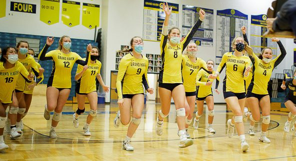 Grand Haven overcomes adversity to beat West Ottawa and claim its 14th straight district volleyball title