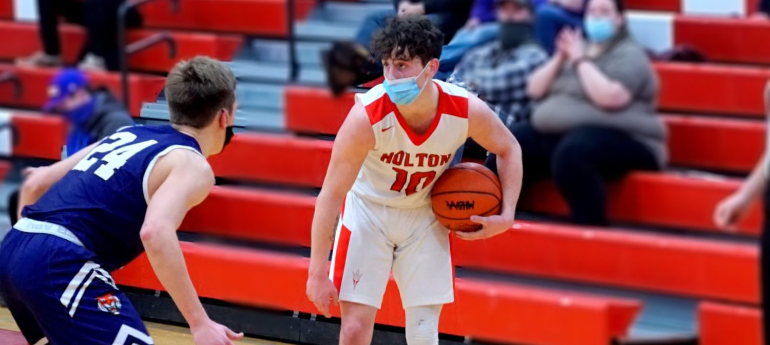 Holton's Poling, motivated by the memory of his father, has led the Red Devils boys basketball team to a red-hot start