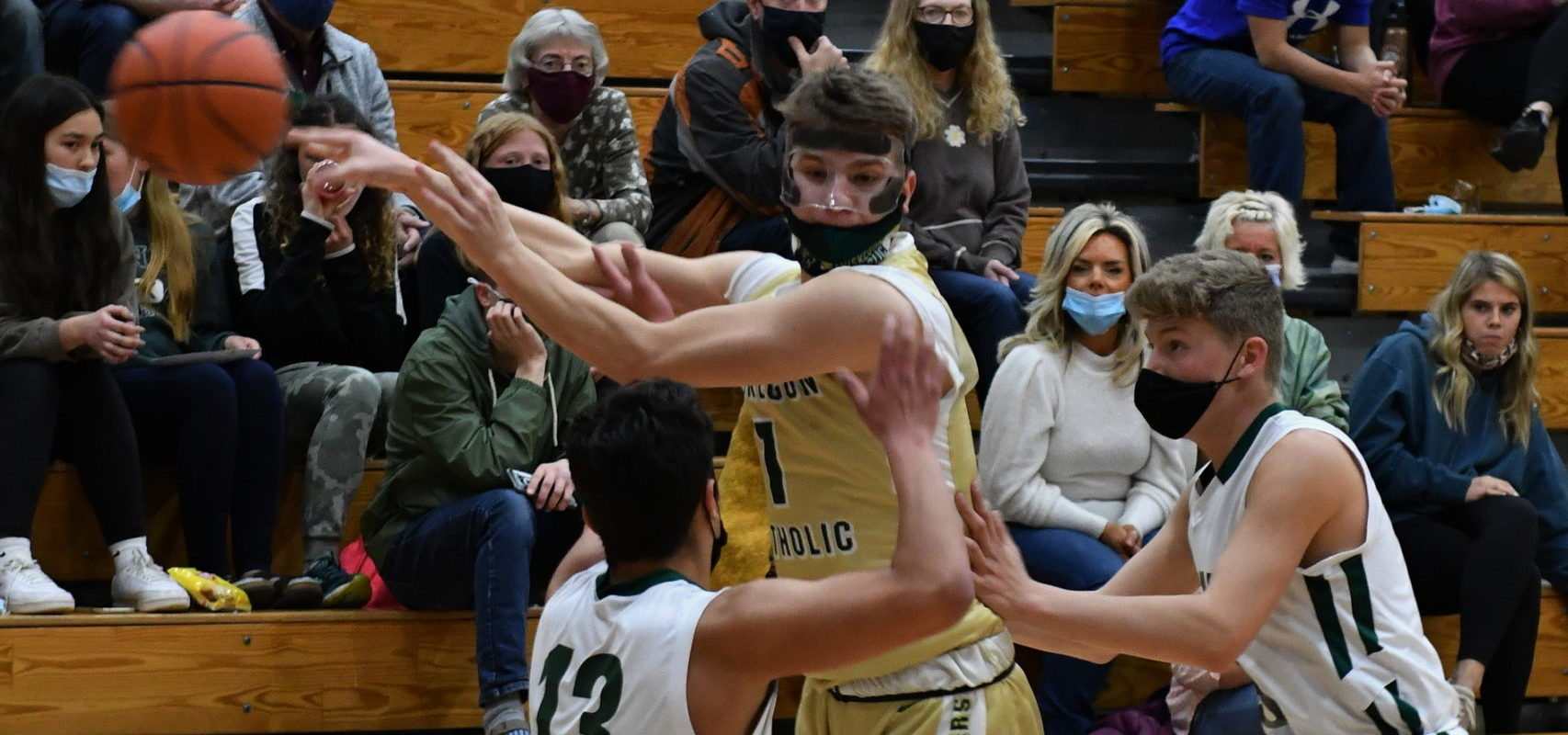 Muskegon Catholic boys put up a tough fight, but fall to Holland Calvary Christian 44-42 in D4 district finals