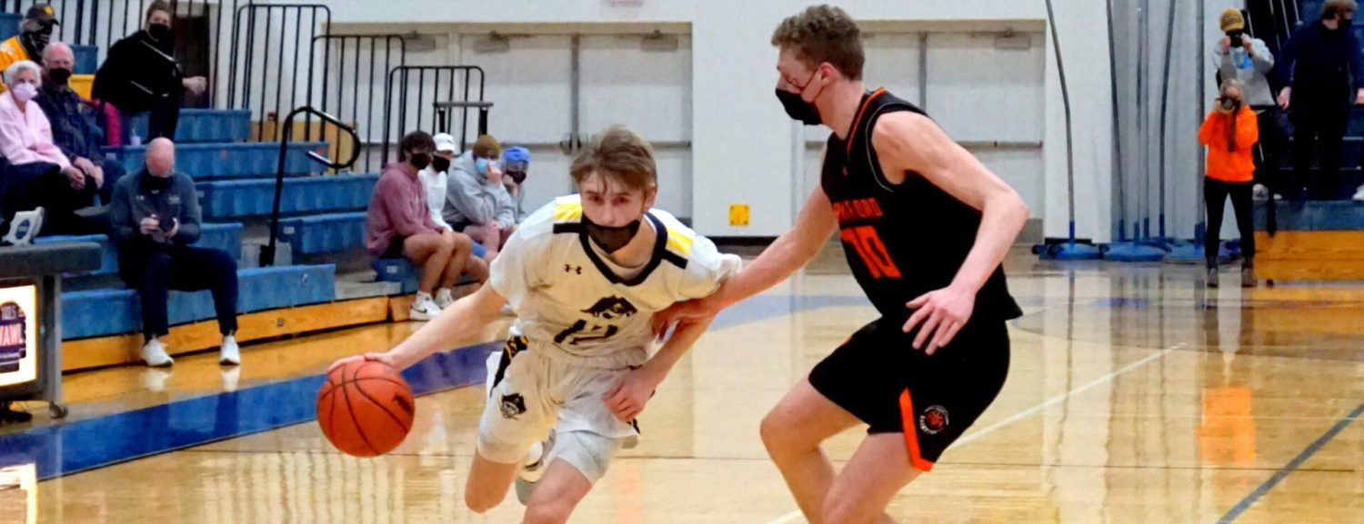 Grand Haven boys employ lockdown defense to defeat first-place Rockford 35-31, keep their O-K Red title hopes alive