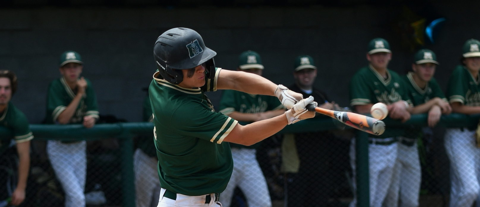 Muskegon Catholic baseball squad outscores two opponents 27-0 to win its ninth straight district championship