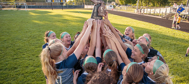 No. 1 ranked North Muskegon girls soccer squad beats WMC 6-0 in district finals, giving new coach his first tournament trophy
